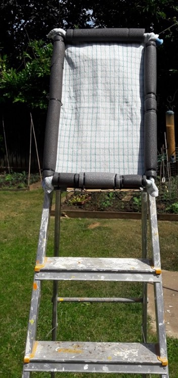 Step ladder with tea-towel.